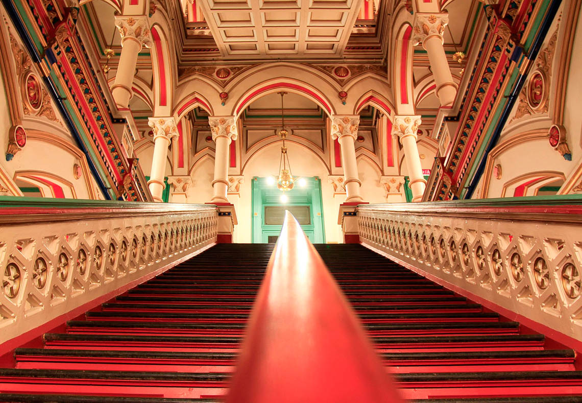 Brightly-colored-gothic-revival-staircase-in-perspective