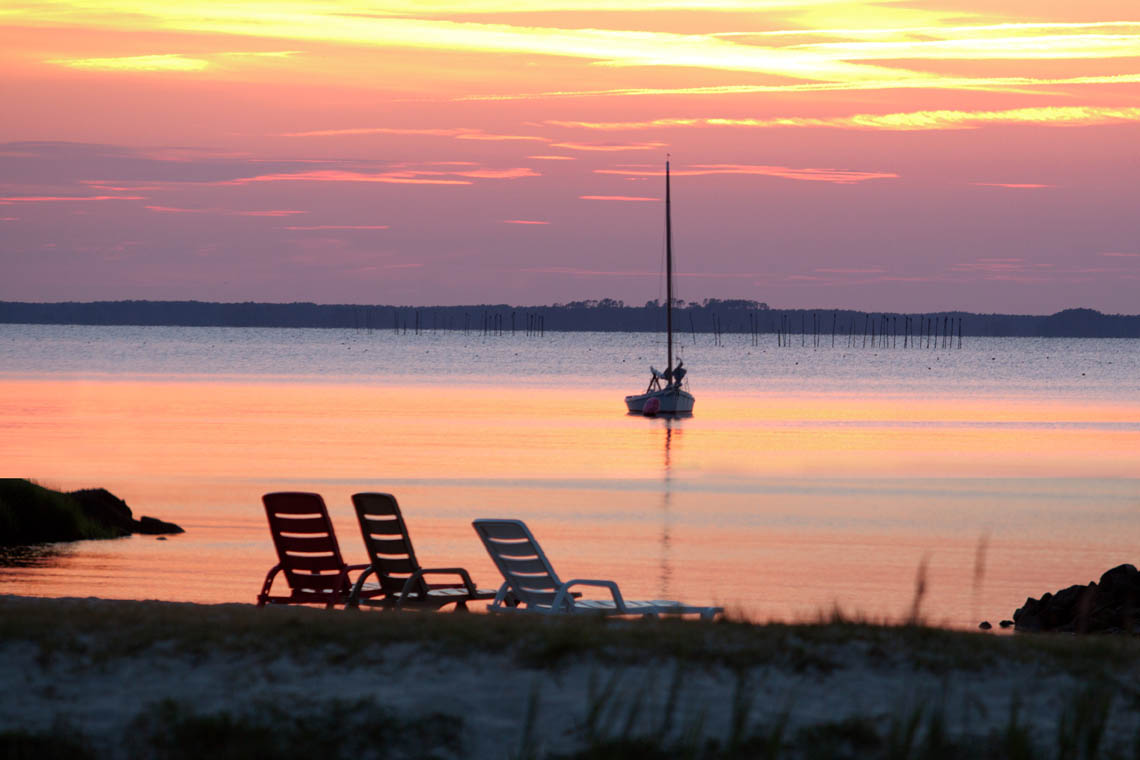 Terri-Aigner_Seascape-Moored-Sailboat-with-Beach-chairs-at-Sunset-50-of-1