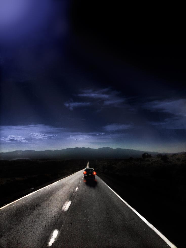 Lone-vehicle-on-midwestern-us-highway-in-moonlight